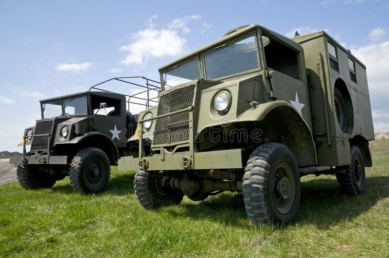 Vintage Military Trucks. A pair of World War Two American trucks in early summer stock photography