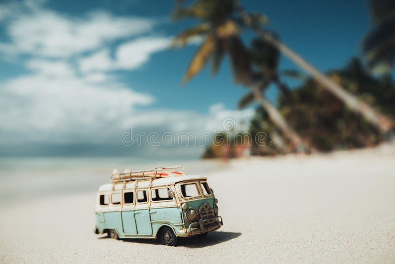 Vintage miniature van on the tropical beach at sunrise royalty free stock images