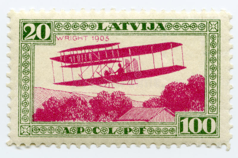 Vintage mint Latvia airmail stamp 1932 Wright brothers biplane stock photo