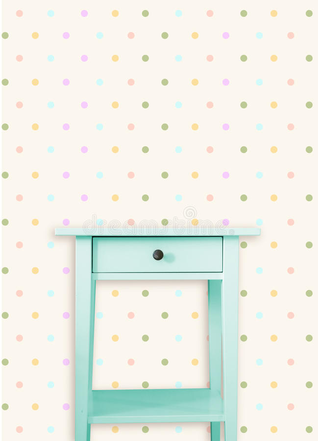 Vintage mint wooden chest drawer near vintage dots wall.  royalty free illustration