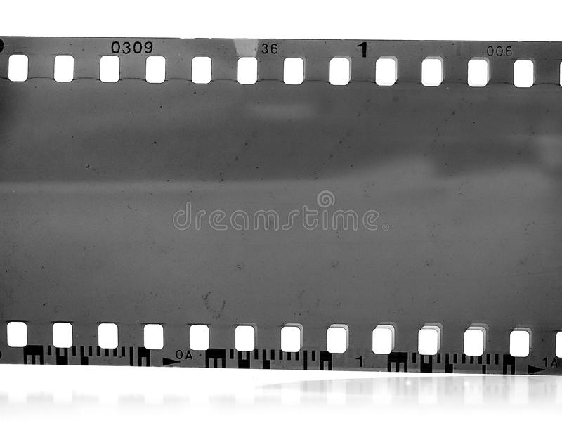 Vintage 35mm black-and-white negative film frame. Blank light leaked highly detailed real vintage 35mm black-and-white negative film frame, hard grain, dust and stock images