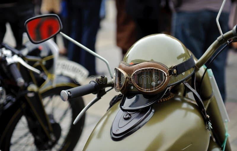 Vintage moto. With a crash helmet stock photography