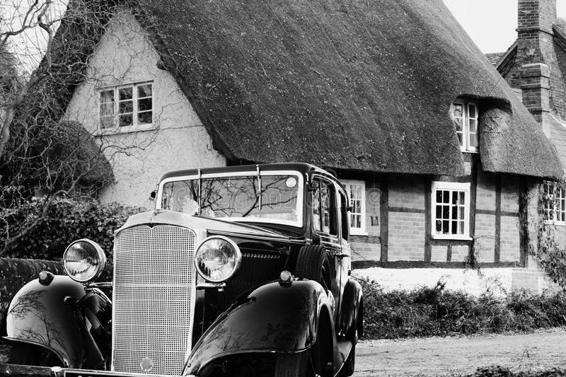 Download Vintage Motor Car Outside A Thatched Cottage Stock Photo - Image: 22432430
