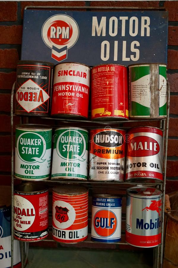 Vintage motor oil cans on display. Old and newer cans of motor old are for sale. Motor oil can be recycled stock image