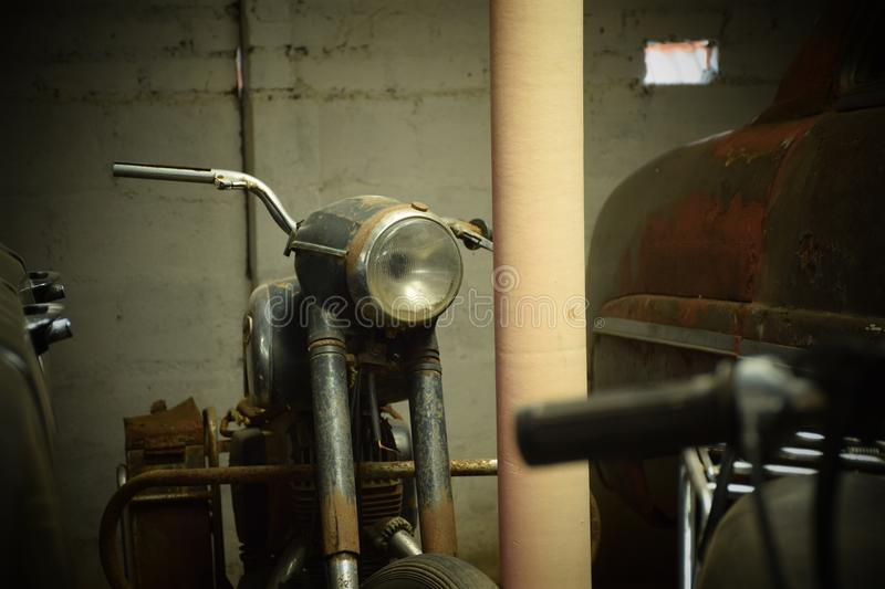 A Vintage Motorcycle in rural India stock photography