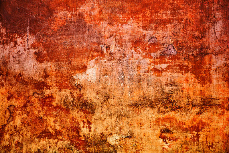 Vintage mottled frame, textured grunge background. Abstract old surface. Closeup of red and orange. Art design process. Colorful scratched background royalty free stock photos