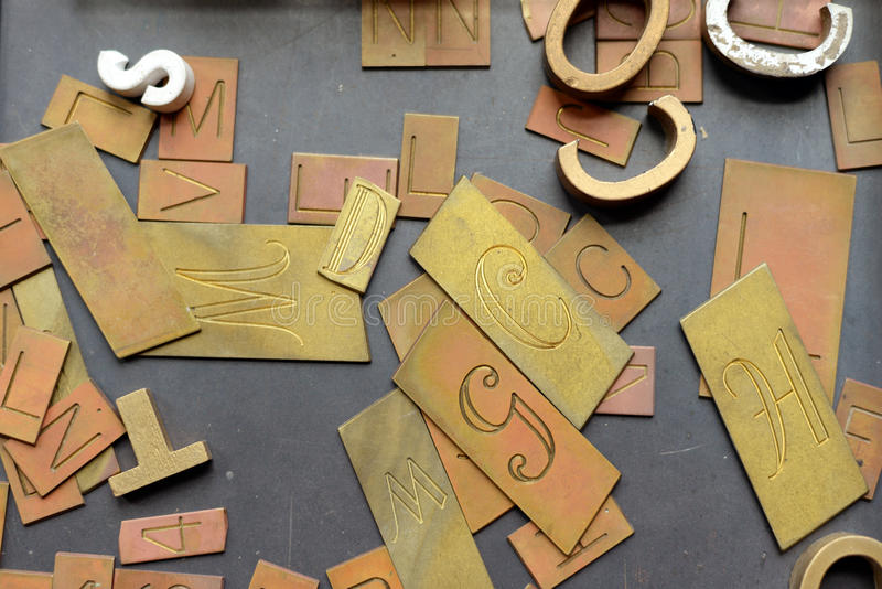 Vintage movable type. Letters on a table stock images