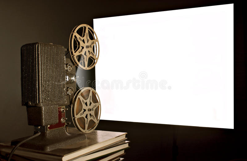 Vintage Movie Projector. A nostalgic view of an old home movie projector in use stock photography