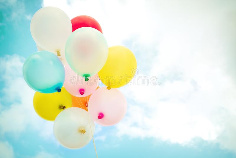 Vintage multicolor balloons with done with a retro instagram filter effect. On blue sky. Ideas for the background of love in summer and valentine, wedding royalty free stock image