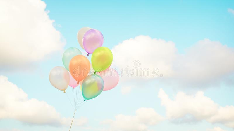 Vintage multicolor balloons with done with a retro instagram filter effect on blue sky. Ideas for the background of love in summer and valentine, wedding royalty free stock photo