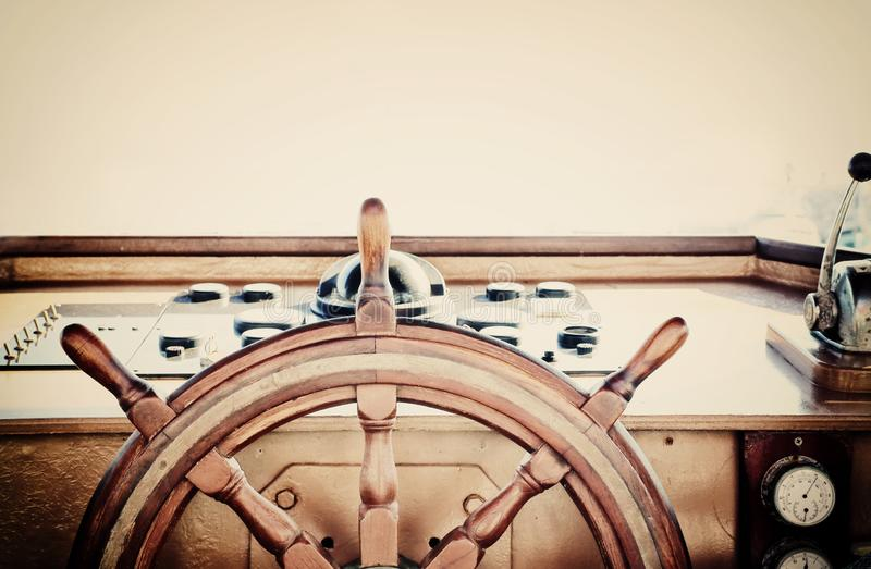 Vintage nautical detail of a ship`s old wooden wheel royalty free stock images