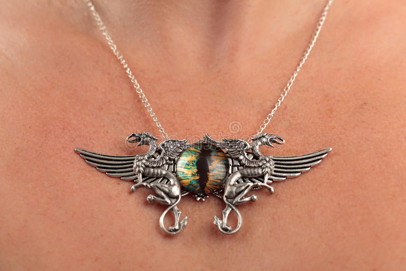 Vintage necklace griffin cateye gem royalty free stock photography