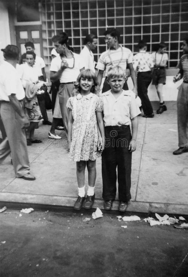 Vintage New York City People, Children. Vintage retro scene of people on the streets of New York City. Photo taken in the nineteen forties royalty free stock photo