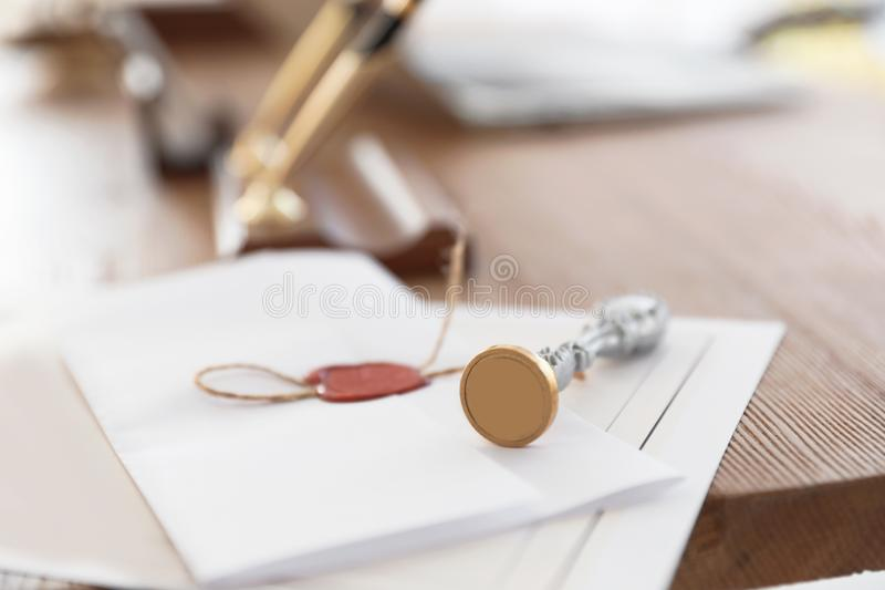 Vintage notary stamp and documents on desk. Closeup royalty free stock images