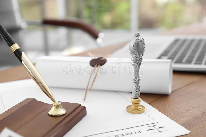 Vintage notary stamp and documents on desk. Closeup stock photos