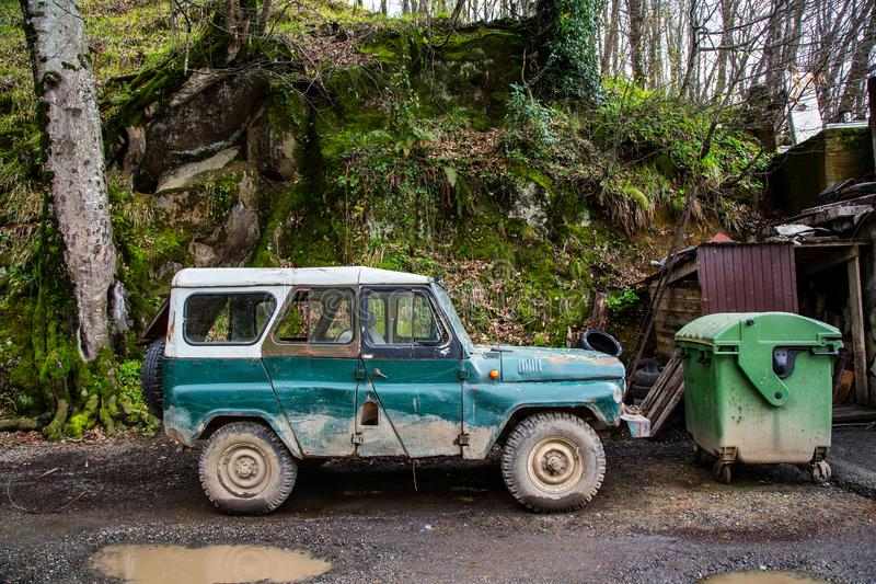 Vintage 4x4 off road truck vehicle at the mountain road. royalty free stock photography