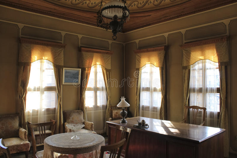 Vintage office - wooden work table and large windows royalty free stock photo