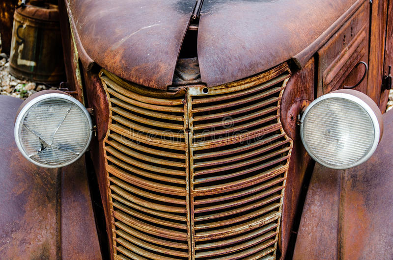 Vintage Oil Truck. Vintage old classic oil, gasoline hauling truck and rusty vehicle showing headlights royalty free stock photo