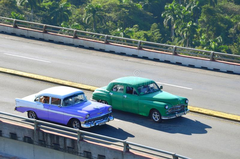 Vintage old American cars from the 50`s in Cuba as taxis on the highest Cuban bridge. Bacunayagua Bridge - the highest bridge 110 m in Cuba between Matanzas and royalty free stock photography