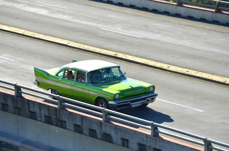Vintage old American cars from the 50`s in Cuba as taxis on the highest Cuban bridge. Bacunayagua Bridge - the highest bridge 110 m in Cuba between Matanzas and stock photos