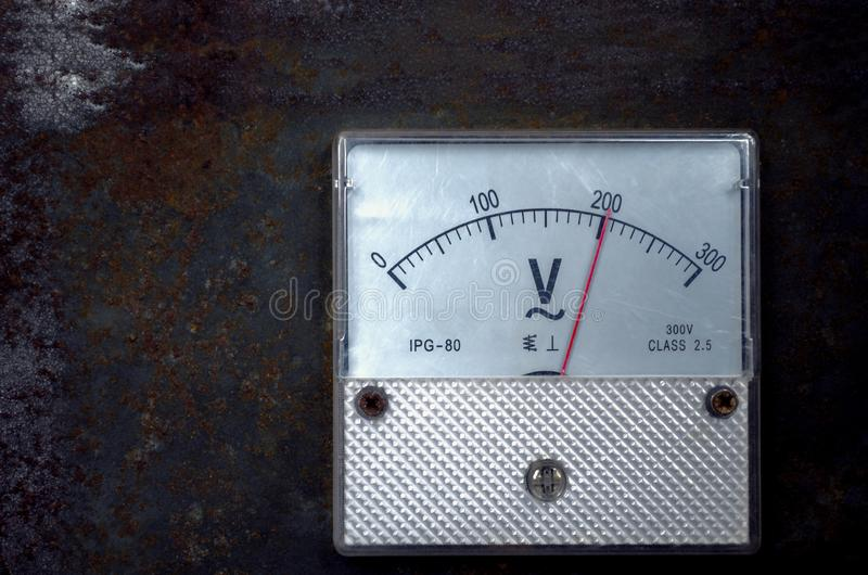 Vintage old analog volt meter scale of measurement device stock photo