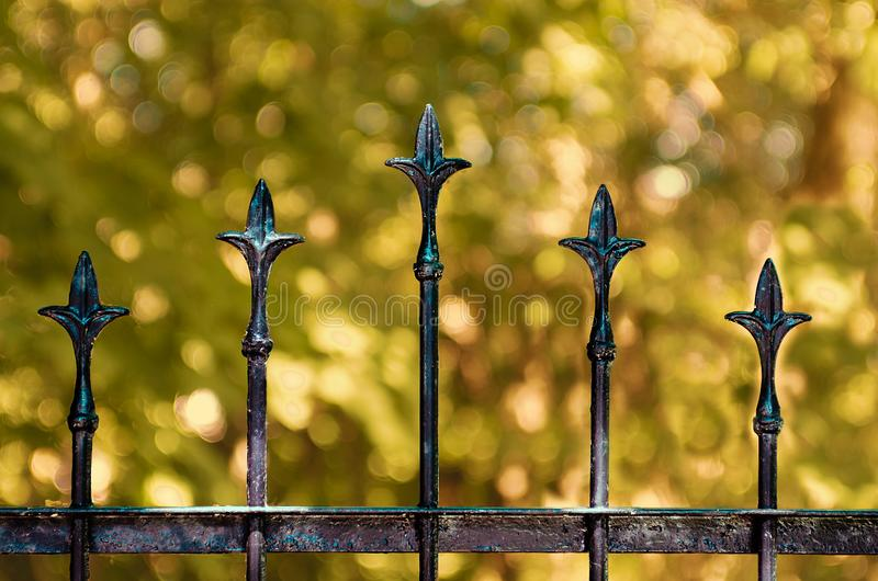Vintage old black wrought-iron fence. The fragment part. royalty free stock photo