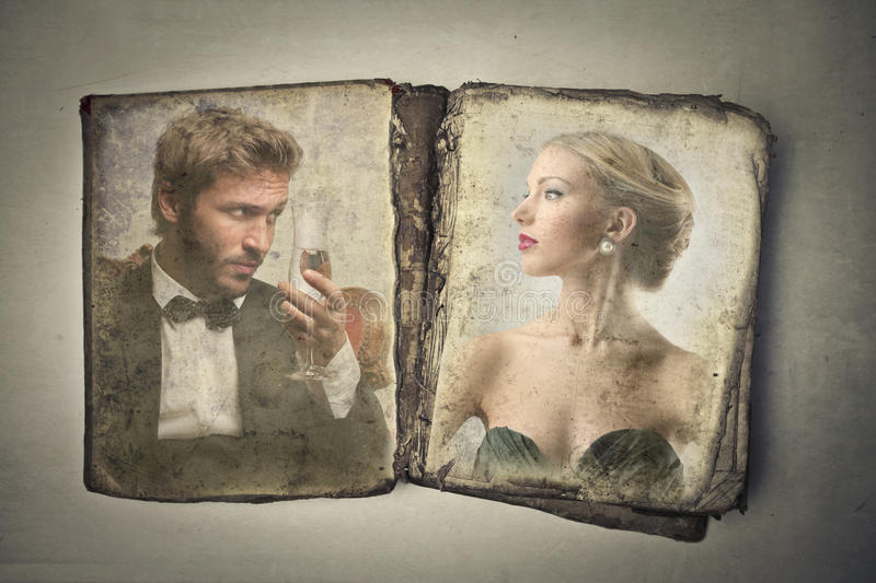 Vintage old book with two portraits royalty free stock photo