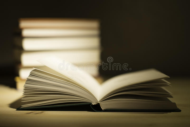 Vintage old books on wooden deck table royalty free stock images