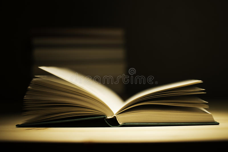 Vintage old books on wooden deck table royalty free stock photo