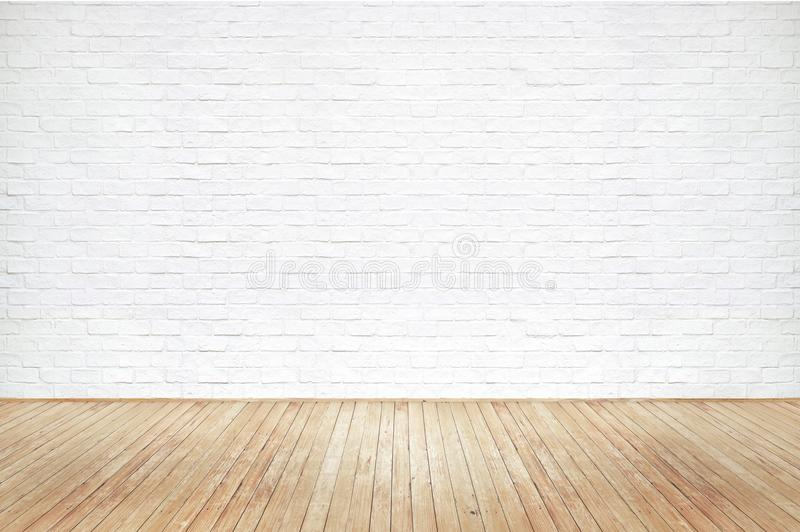 Vintage old brown wooden floor texture and white brick wall royalty free stock photo