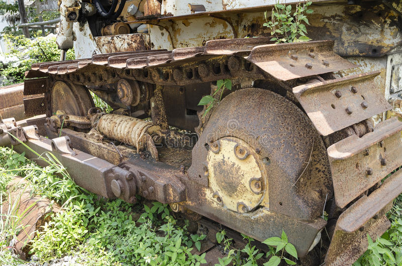 Vintage old caterpillar track of a tractor. Old, rusty, and weathered bulldozer track royalty free stock photos