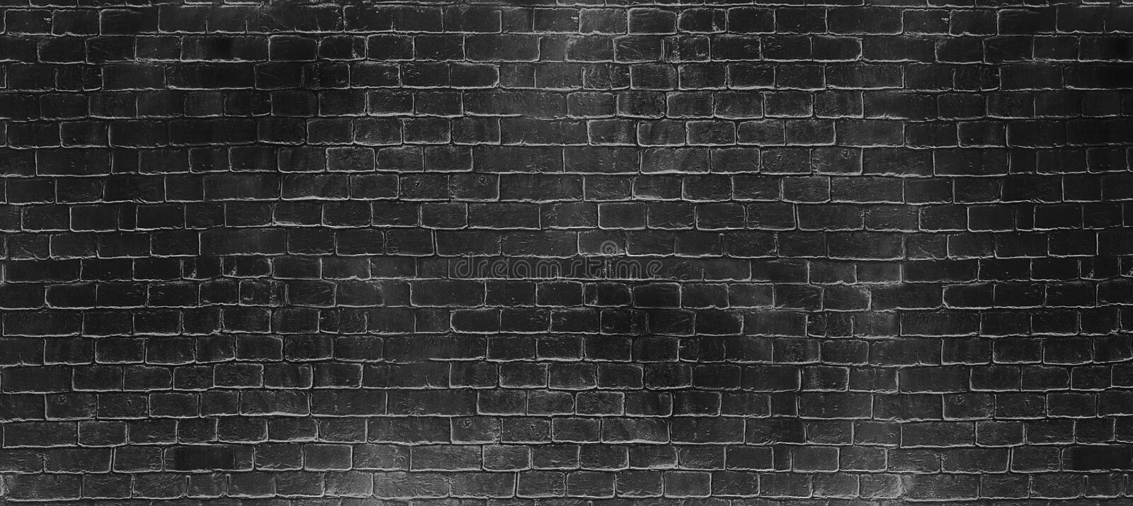 Vintage old dark black wash brick wall texture. Panoramic background for your text or image royalty free stock images