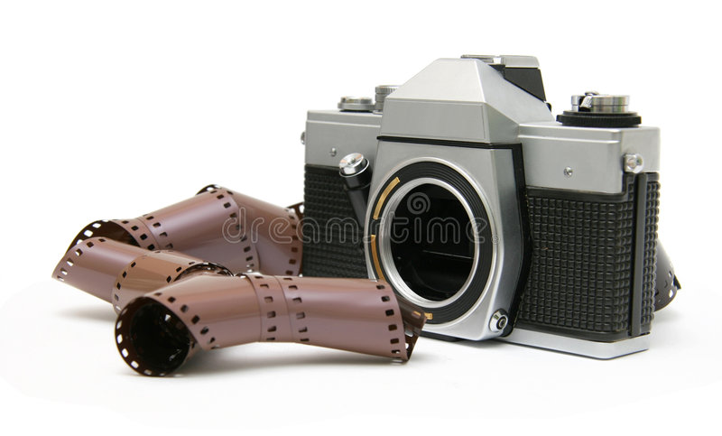 Vintage old film camera with film strip. Professional old film camera, without lens, with film strip. Isolated on white background royalty free stock images
