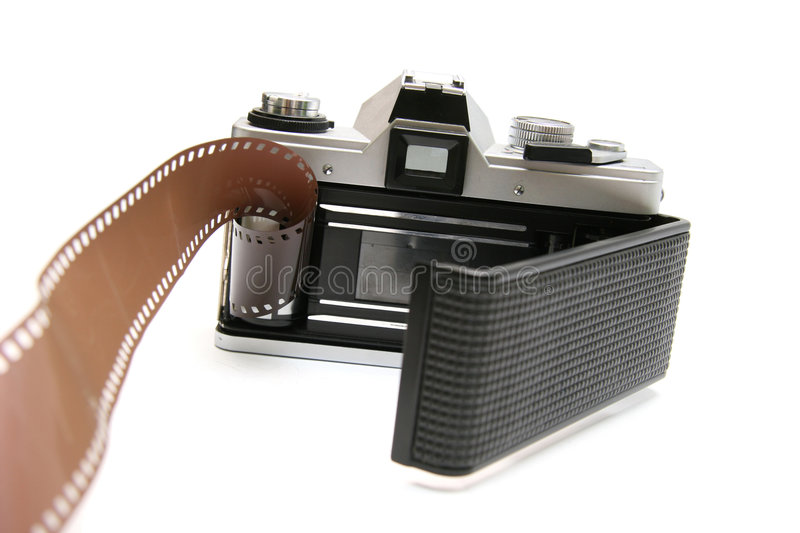 Vintage old film camera with film strip. Professional old film camera, with film strip. Isolated on white background stock photo