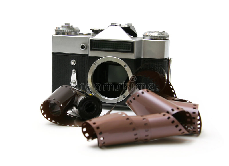 Vintage old film camera with film strip. Professional old film camera, with film strip. Isolated on white background royalty free stock photography