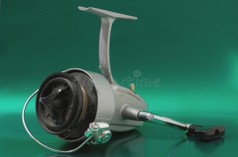 Vintage Old Fishing Reel. One Vintage Old Fishing Reel on a Colored Background royalty free stock image