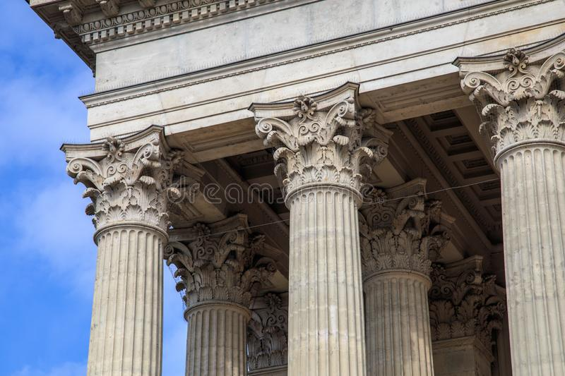 Vintage Old Justice Courthouse Column. Neoclassical colonnade with corinthian columns as part of a public building royalty free stock images