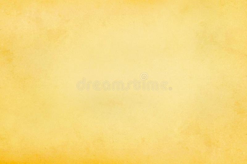 Vintage old light beige and yellow paper parchment texture background royalty free stock images