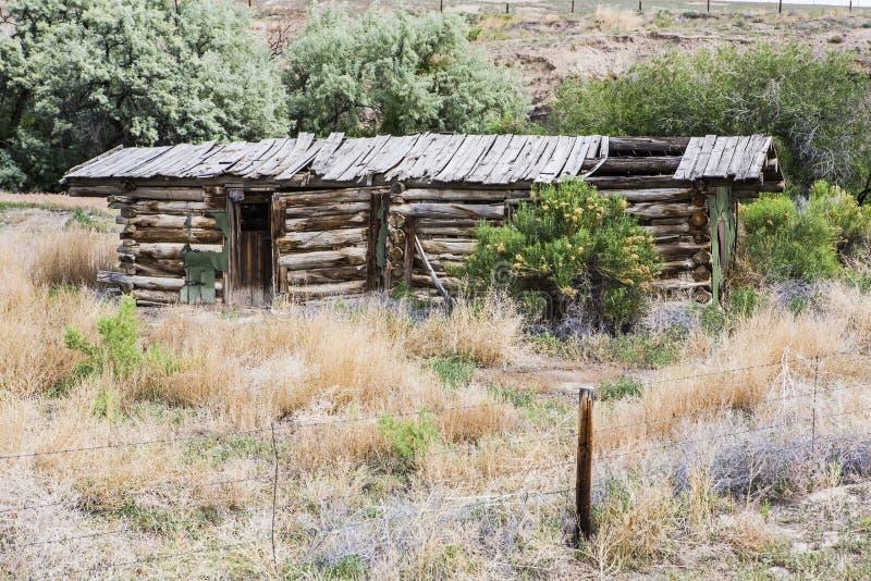 Vintage old log cabin desert badlands royalty free stock images