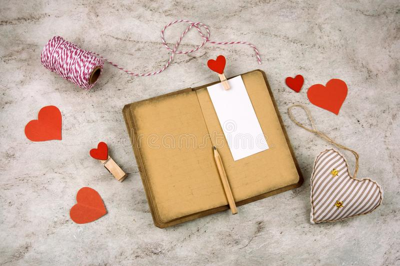 Vintage old paper,pencil and stuffed toy heart royalty free stock photography