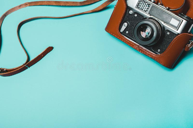 Vintage old photo camera on a blue background royalty free stock images
