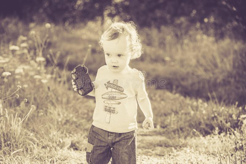 Vintage old photo of child in nature stock images
