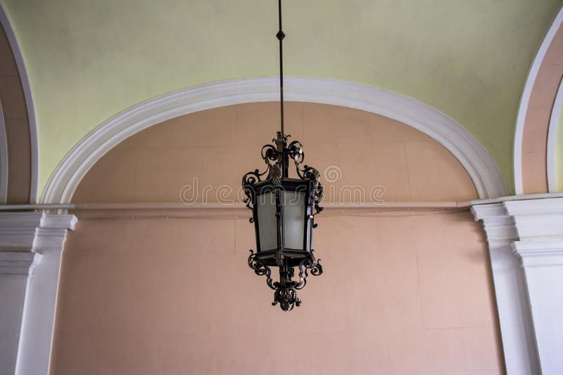 Vintage Old Street Classic Iron and Glass Lantern On The House Wall, Close Up royalty free stock images