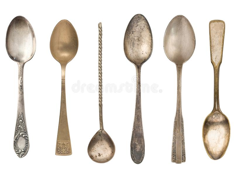 Vintage old tea spoons isolated on white background stock photos
