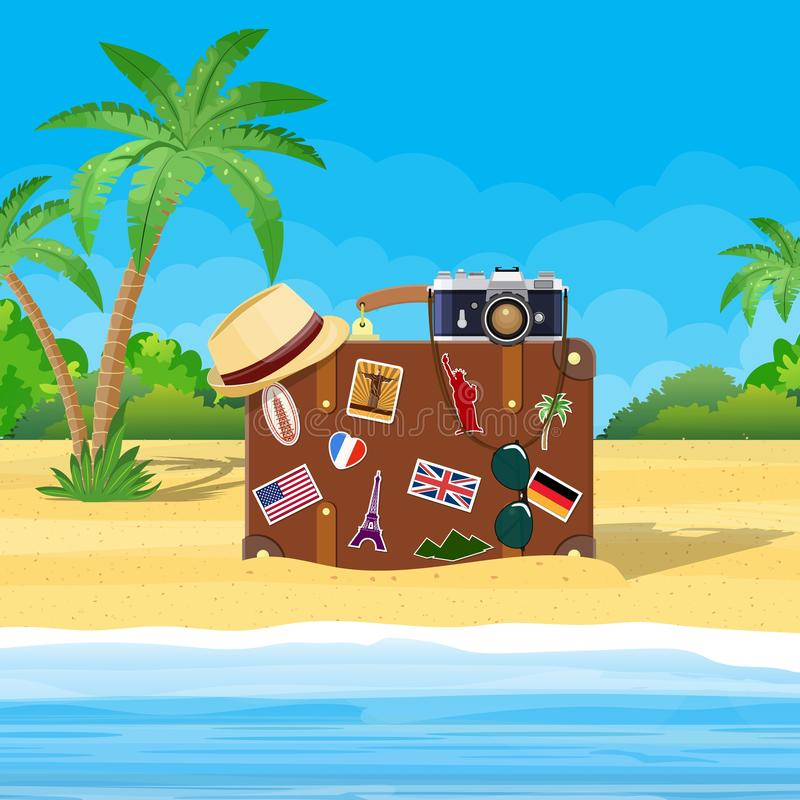 Vintage old travel suitcase on beach. royalty free illustration