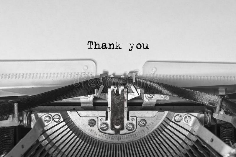 Vintage old typewriter on white background with text thank you. Close up. stock images