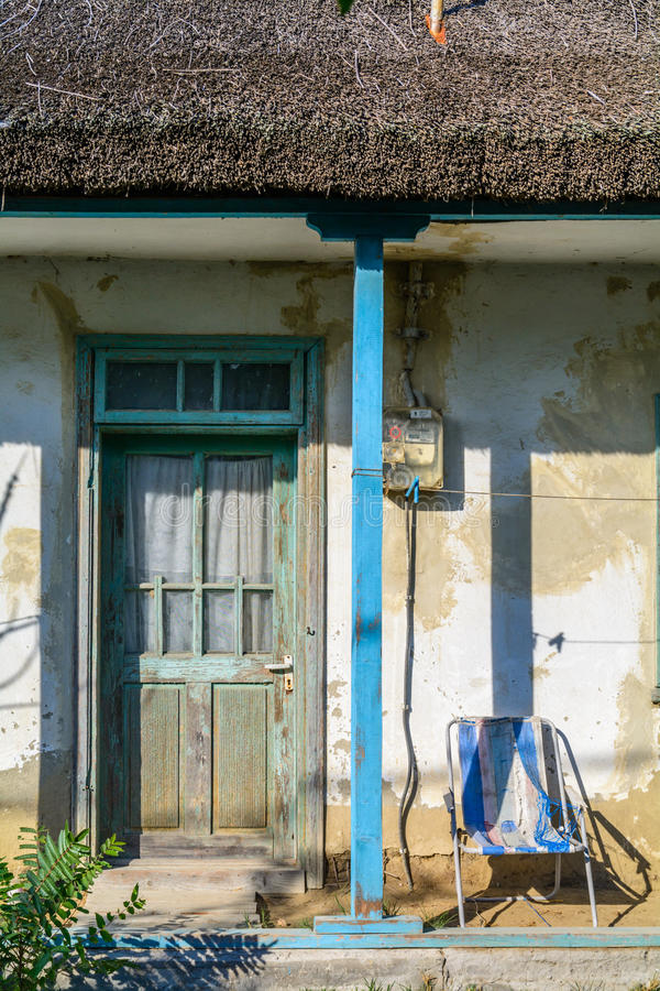 Vintage old wall with green door and blue pillars. Front side en stock photos