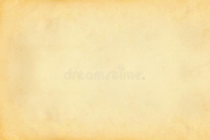 Vintage old yellow and beige paper parchment textured background stock photography