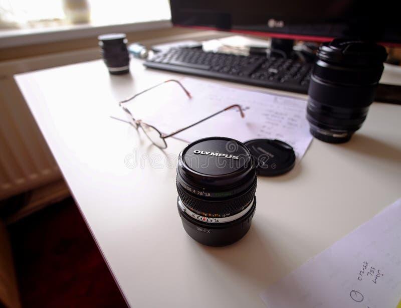 Vintage Olympus SLR lens and Fuji Lens. Olympus 50mm SLR vintage lens and Fuji 18-135 modern x-mount lens royalty free stock photography