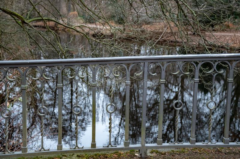 Vintage ornate metal railing gratings of old bridge over lake in Tiergarten park of Berlin Germany. Antique lattice. Tiergarten public park of Berlin Germany stock image